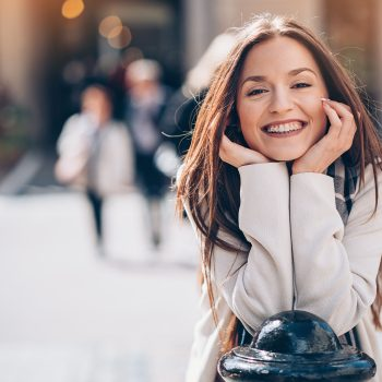 Smiling young woman outdoors in the city